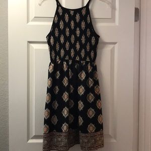 Razorback pattern black dress